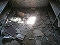 Books on floor of library at former Stara Gradiska Prison.jpg