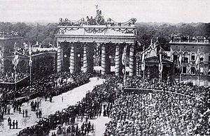 Pariser Platz - The Brandenburg Gate in 1871 with decorations and victorious Prussian troops after the Franco-Prussian War