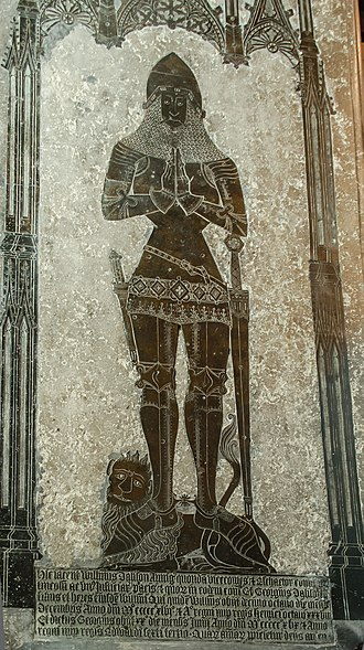 William Dalison (died 1546) - All Saints' church, Laughton, Lincolnshire, anachronistic re-used monumental brass made circa 1405, of a knight wearing the style of armour worn at the Battle of Agincourt (1415), with Gothic-style canopy, serving as ledger stone for the remains of William Dalison (died 1546), with inscription for Dalison made in imitation Gothic script below. William Dalison lived well into the Rennaissance age in England when the taste for the Gothic style had long passed