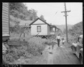 Bringing home groceries. All streets are unpaved, no sidewalks, no camp maintenance. Kingston Pocahontas Coal... - NARA - 540742.tif