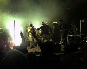 Emmanuel Jal - Emmanuel Jal (left in yellow) in concert in Bristol on 11 March 2006