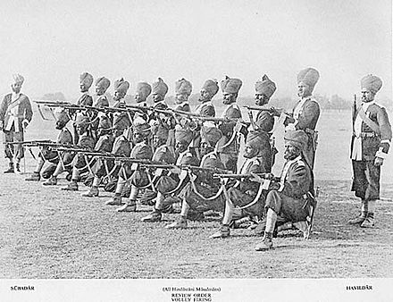 A group of Indian soldiers posing for volley firing orders, c. 1895. BritishIndianArmy.jpg