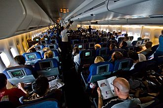 Travel - Travelers in a British Airways 747 airplane. Air travel is a common means of transport.