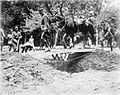 British cavalry crossing a trench bridge.jpg