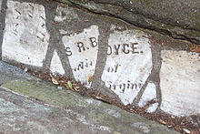 Fragments of a headstone reading S R.BOYCE.