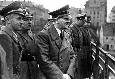 "Adolf Hitler in Maribor, Yugoslavia in 1941. He later ordered his officials ""to make these lands German again"". Bundesarchiv Bild 121-0723, Marburg-Drau, Adolf Hitler.jpg"