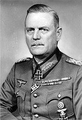 a black and white image of a man in uniform