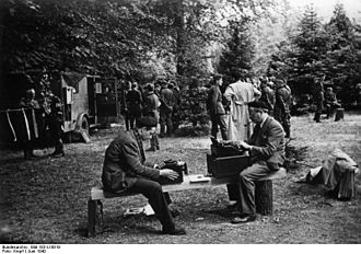 William L. Shirer - Shirer, at right, at Compiègne reporting on the French surrender