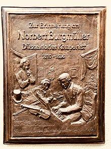 Gedenktafel für Norbert Burgmüller in Düsseldorf, Bastionstraße, geschaffen von Ulrich Grenzheuser (Quelle: Wikimedia)