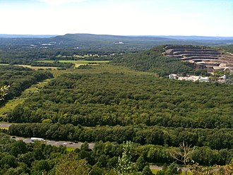 Mattabesett Trail - View from Higby Mountain of Interstate 91 and the eastern quarry face of Chauncey Peak. In the far distance is Lamentation Mountain's long ridge.