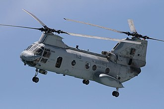 "Boeing Vertol CH-46 Sea Knight - A U.S. Marine Corps CH-46 ""Phrog"" of HMM-364 flies over Huntington Beach, California in October 2011."