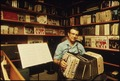 CHRISTY HENGEL, IS ONE OF A FEW MANUFACTURERS OF CONCERTINAS IN THE U.S. TODAY. HE HAND CRAFTS HIS INSTRUMENT WHICH... - NARA - 558358.tif