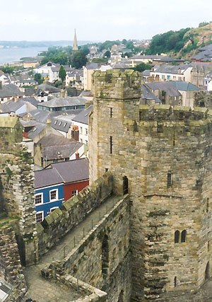 "Welsh toponymy - The castle at Caernarfon (meaning in Welsh ""the fortress in Arfon""), which was formerly anglicised as ""Carnarvon"" or ""Caernarvon"". The name ""Arfon"" refers to the area ""opposite Môn"" or Anglesey."