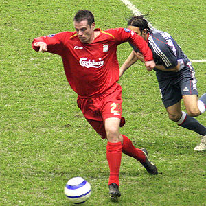 Jamie Carragher - Carragher in action against Benfica.