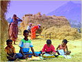 Children studying and farmers working.jpg