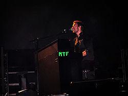 Make Trade Fair, abbreviated as MTF, shown on Chris Martin's piano during a concert