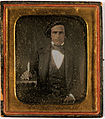 Daguerreotype. Portrait of a man with a book and pen..jpg