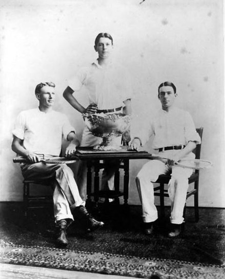 American player Dwight Davis (center) in 1900 with the trophy he committed to build.