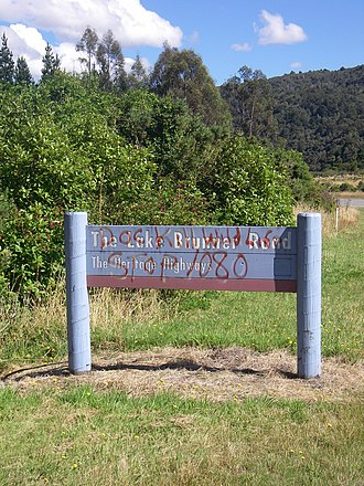1080 usage in New Zealand - Road sign on the West Coast with graffiti opposing the use of 1080