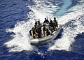 Defense.gov News Photo 120401-N-RI884-011 - Members of a visit board search and seizure team return their rigid-hull inflatable boat to the guided missile destroyer USS Paul Hamilton DDG 60.jpg