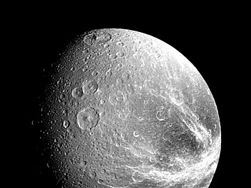 Fractured terrain on Dione imaged from a distance of 240,000 km from Voyager 1