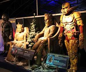 The Doctor, the Widow and the Wardrobe - Several costumes and creatures in the episode, the spacesuit from the start of the episode, the Wooden Queen and King, and the Harvest Ranger costumes, on display at the Doctor Who Experience.