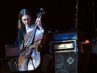 This image shows musician Don Kerr playing cello through a bass amplifier. While bass amplifiers are typically designed for the electric bass and/or the double bass, other instrumentalists use bass amps, including some electric guitarists and other instrument players.