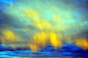 Sunset - Illuminated downdraft wind shear clouds in the eastern sky near dusk mimic aurora borealis in the Mojave Desert