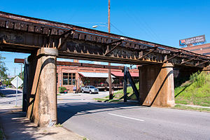 11 foot 8 Bridge - A view from under the bridge, facing traffic. Just below the bridge, is a wide-flange steel H-beam to protect it from over-height trucks. The beam's web is horizontal to better absorb the shear force of  truck collisions. The vertical flanges spread the impact.