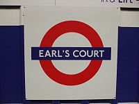 Earl's Court stn District roundel refurb.JPG