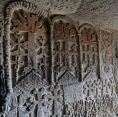 Engraved crosses on the cave church wall in the Geghard Monastery.jpg