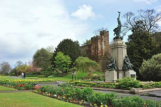 """Northernhay Gardens - The war memorial with """"Athelstan's Tower"""" on the city wall behind"""