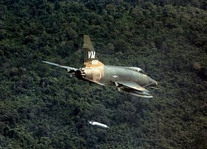 Phan Rang Air Base - North American F-100D-25-NA Super Sabre 55-3658 of the 352d Tactical Fighter Squadron dropping a napalm bomb near Biên Hòa, South Vietnam, 1967.