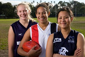 Women's Australian rules football - Players in the Victorian Women's Football League, 2008, left to right: Phoebe McWilliams, Rachel Achampong and Avril Chow