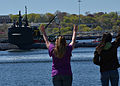 Family members wave to U.S. Sailors on the attack submarine USS Dallas (SSN 700) as it leaves Groton, Conn., May 3, 2013 130503-N-TN558-169.jpg