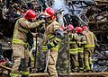 Firefighters at the Plasco.jpg