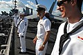 Flickr - Official U.S. Navy Imagery - A Senior Chief talks with Sailors as they man the rails..jpg