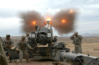 Muzzle brake - The muzzle brake of an M198 155mm howitzer venting propellant gases sideways as the howitzer is fired