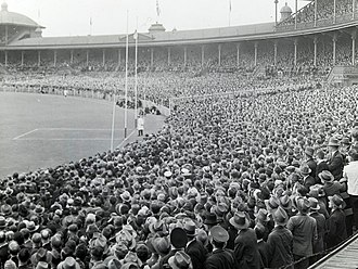 Crowd during a VFL football match, early 1900s Football crowd MCG.jpg