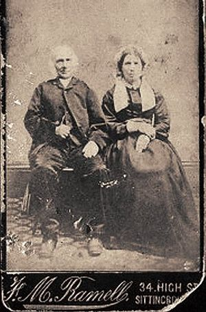 Lappet - Nineteenth century British couple. The lady is wearing lappets hanging down on each side of her neck.