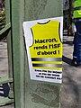 "Gilets jaunes, Paris - 20 Apr 2019 - Sticker ""Macron, rends l'ISF d'abord !"".jpg"