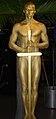 Gold oscar human statue (14617026795).jpg