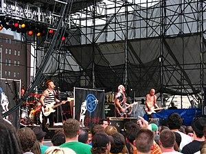 Goldfinger (band) - Goldfinger live in Philadelphia  in June 2008. From left to right: Darrin Pfeiffer, Kelly LeMieux, John Feldmann and Charlie Paulson