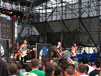 Goldfinger (band) - Goldfinger live in Philadelphia  in June 2008. From left to right: Darrin Pfeiffer, Kelly LeMieux, John Feldmann and Charlie Paulson