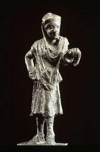 Theatre of ancient Greece - Bronze statue of a Greek actor. The half-mask over the eyes and nose identifies the figure as an actor. He wears a man's conical cap but female garments, following the Greek custom of men playing the roles of women. 150-100 BCE.