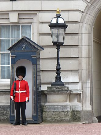 Queen's Guard - Sentry of the Grenadier Guards posted outside Buckingham Palace