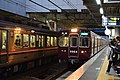 Hankyu 3300 series at Minami-Ibaraki Station 2019-11-17 (49929264556).jpg
