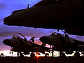 Harrier GR7s and Sea Harrier FA2s, are shown waiting on the deck of HMS Invincible at sunset, during Marstrike 05. MOD 45145956.jpg