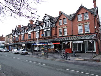Heaton Moor - Shopping arcade with wrought iron and glass canopy