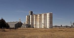 Heckville, Texas - Steel grain elevator alongside the abandoned tracks of the former Fort Worth and Denver South Plains Railway